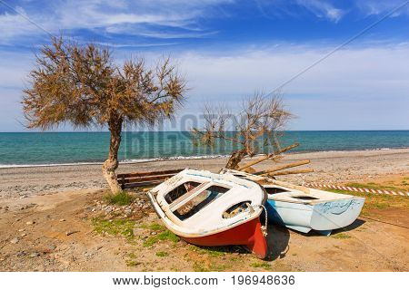 Old boats at Maleme beach on Crete, Greece