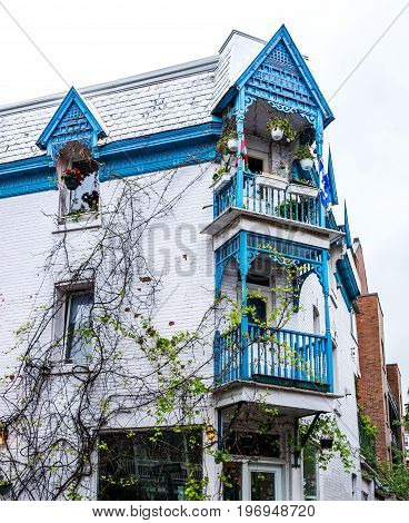 Montreal, Canada - May 26, 2017: Blue House In Plateau Area Of City In Quebec Region During Wet Rain