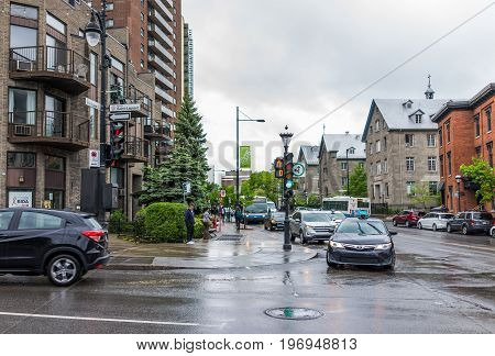 Montreal, Canada - May 26, 2017: Saint Laurent Boulevard And Sherbrooke Signs In Plateau Area Of Cit