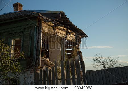 Damaged Russian style old house low angle