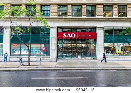 Montreal, Canada - May 26, 2017: Downtown Area Of City In Quebec Region With Saq Store And Red Sign