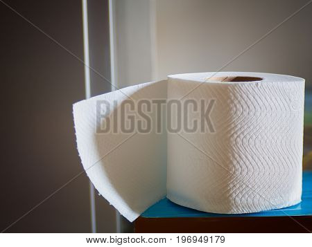 (Close up) Toilet paper on wood background health and sanitation.