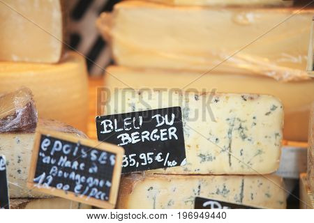 Blue cheese close-up. Cut cheese on storefront.