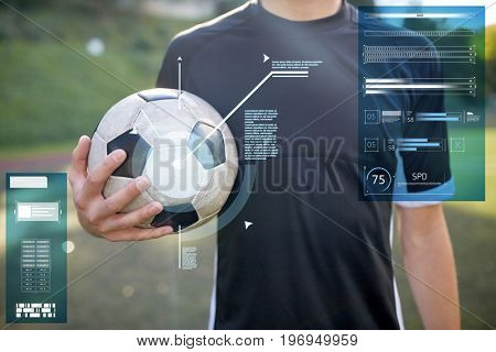 sport, technology and people concept - close up of soccer player with ball on football field