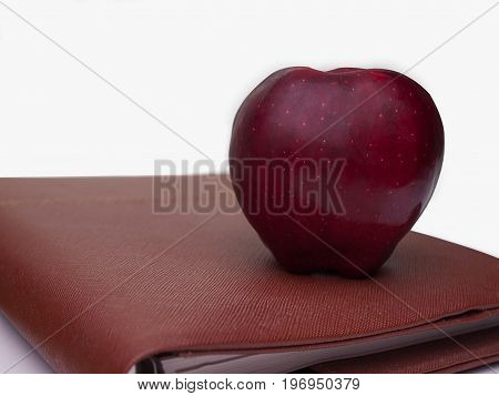 Diet plan book With Fruit apples placed on top Food and health.