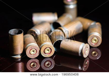 Beautifully grouped with empty shells of 9 mm pistol close up