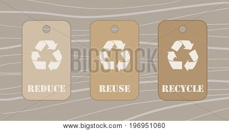 Reduce reuse recycle tags over a wood table