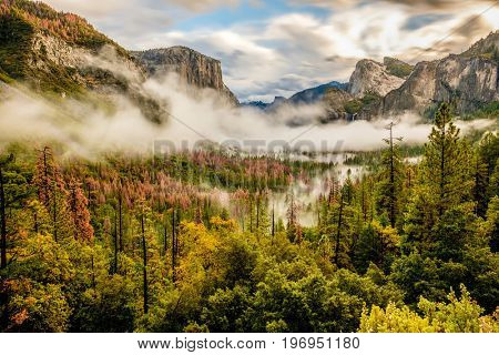 Yosemite National Park Valley at cloudy autumn morning from Tunnel View. Low clouds lay in the valley. California, USA.