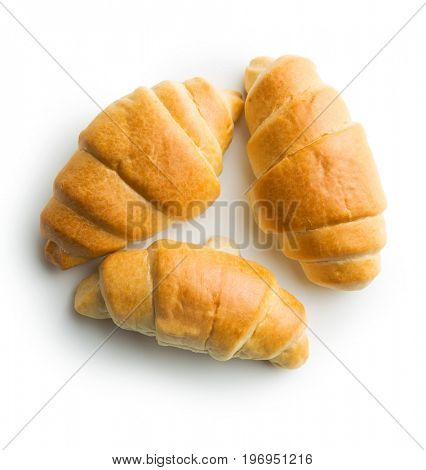Tasty buttery croissants isolated on white background.