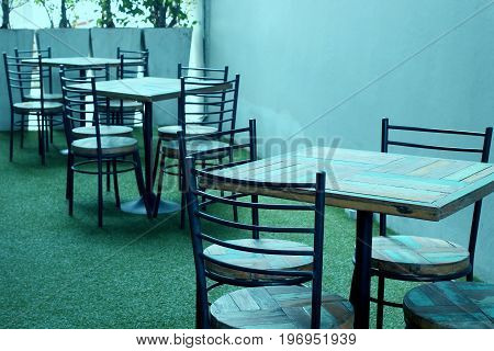 Empty Wooden And Chair Set On Patio