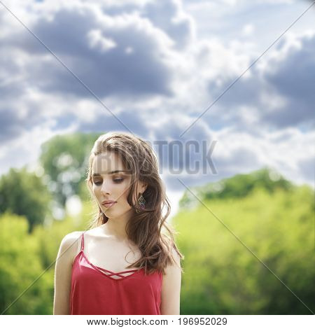 Portrait close up of young beautiful happy woman Ñ?Ñ? red dress, summer outdoors