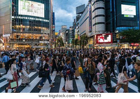 Crowd Of People On Famous Shibuya Crossing In Tokyo At Night