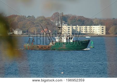 East Providence Rhode Island USA - November 13 2005: Fishing vessel Virginia Lynn making its way up Providence River