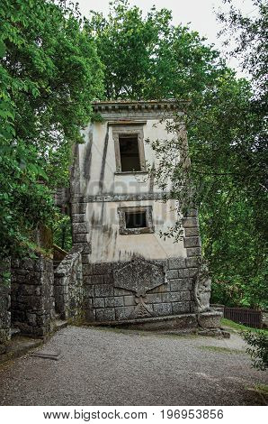 Bomarzo, Italy - May 20, 2013. View of house amidst the vegetation in the Park of Bomarzo. Also known as Park of Monsters, it was created to surprise the visitor with surrealistic works in stone. Lazio region, central Italy