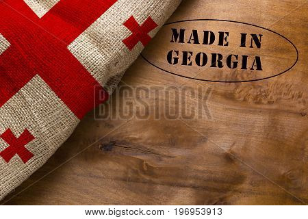 Stamp Made in Georgia poster with the national flag of Georgia.