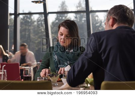 Loving couple looking at eachother during the lunch. Happy smiling couple having lunch at restaurant.