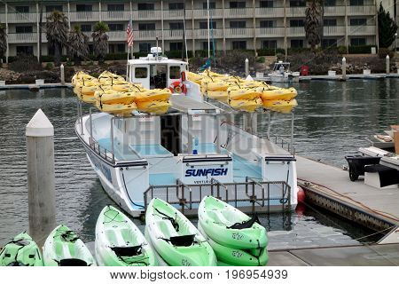 OXNARD CA USA - JULY 4 2013: Recreational boats at the dock in Oxnard marina ready for an open sea trip Ventura county Southern California Pacific coast; copy space