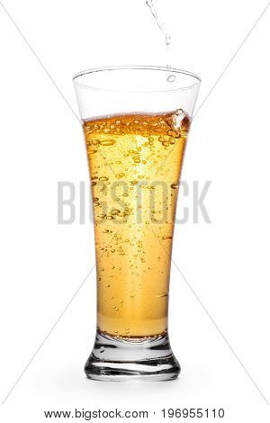 Beer in the glass with splash and bubbles. Isolated on white