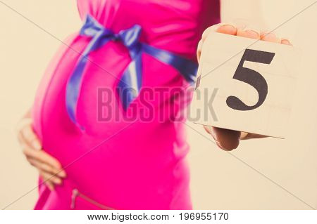 Vintage Photo, Hand Of Woman In Pregnant Showing Number Of Fifth Month Of Pregnancy, Expecting For B