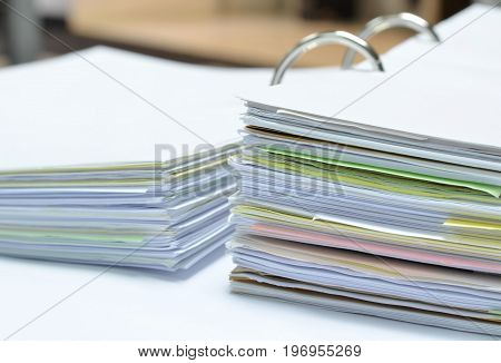 Pile of papers and business documents on white table at workplace,business concept,office supplies.