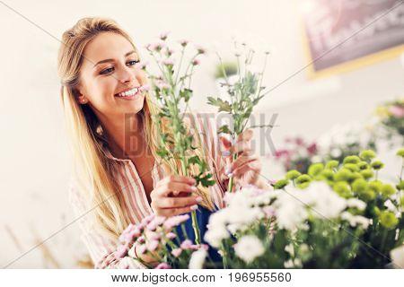 Female florist working in flower shop