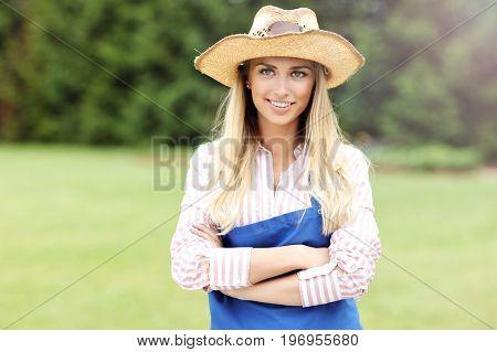 Woman gardener standing outside
