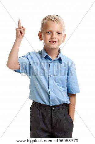 Portrait of little genious boy with raised finger having an idea