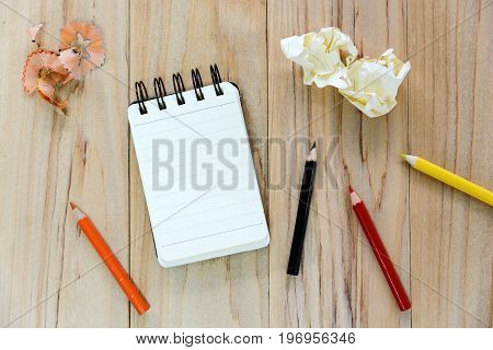 Small Note Book Paper (notepad) For Writing Information With Color Pencil And Crumpled Paper Balls O