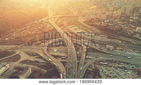 Aerial Drone Flight View of freeway busy city rush hour heavy traffic jam highway. Top view. Cityscape in sunset soft light. Instagram vintage filter toning. Kiev, capital of Ukraine