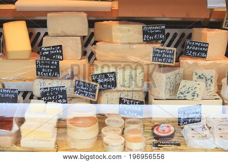 Brussel, Belgium - July 16, 2017: Many sorts of cheese on storefront. Food sales theme.