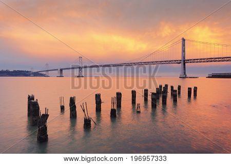 The Bay Bridge at sunset San Francisco California USA