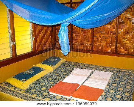 Kho Lipe, Satun, Thailand - February 07, 2011: Wooden bedroom interior at bungalow at at Mountain Resort at Thailand Kho Lipe, Satun, Thailand on February 07, 2011