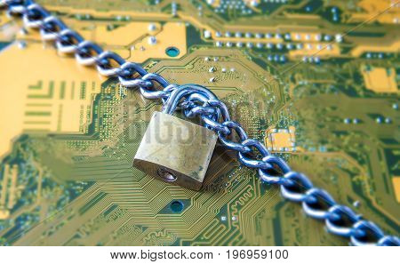 Data Security Encryption Protection Concept with Metallic Padlock chained over electronic circuit board background.
