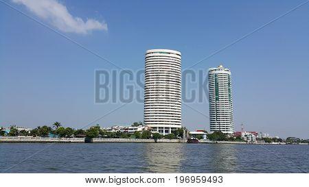 The high building at Chao Phraya riverside Bangkok , Thailand.