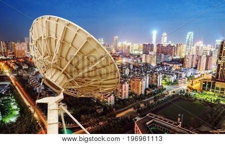 City night view and dish antenna Shanghai china.