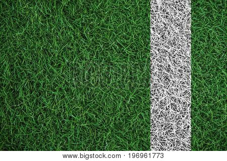Green turf grass texture with white line, in soccer field