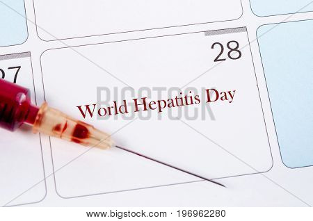 28 July calendar page and sample blood for hepatitis test. World hepatitis day concept.