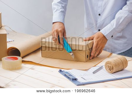 Delivery Man Packing Up On Work Place In Post Office