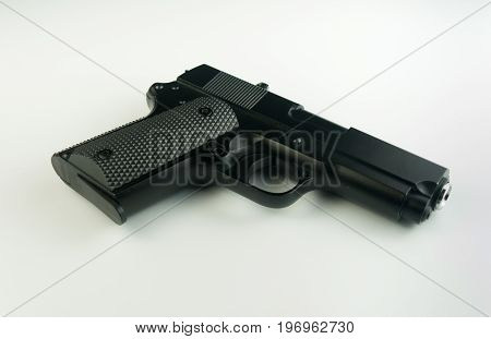 Black BB gun on white background .