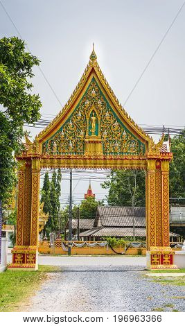 The gate which is the temple entrance. The magnificent construction is full of Thai art.