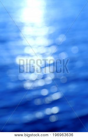 Tranquil scene of blue sea abstract light bokeh on water for background.