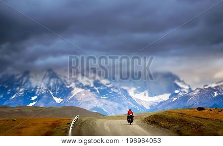 Girl cycling in Torres del Paine National Park, Chile, South America