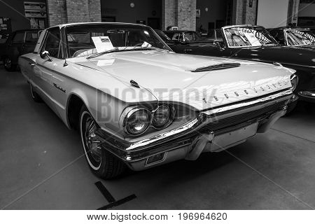 BERLIN - MAY 10 2015: A large personal luxury car Ford Thunderbird 390 Coupe (second generation) 1964. Black and white. The 28th Berlin-Brandenburg Oldtimer Day