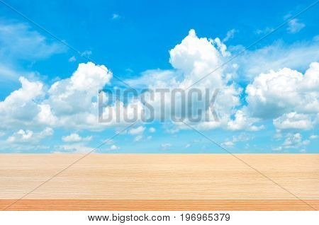 Wood table top on bright summer blue sky background - can be used for display or montage your products