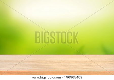 Wood table top on abstract nature green background - can use for display or montage you products