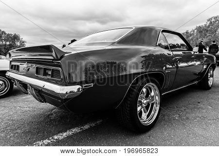 BERLIN - MAY 10 2015: Pony car Chevrolet Camaro Z/28 (first generation). Black and white. Rear view. 28th Berlin-Brandenburg Oldtimer Day