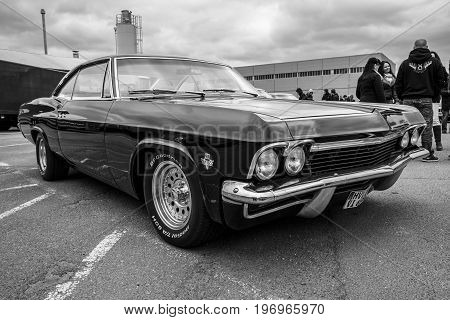 BERLIN - MAY 10 2015: Full-size car Chevrolet Impala (fourth generation). Black and white. 28th Berlin-Brandenburg Oldtimer Day