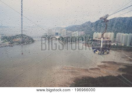 Blurred view from NgongPing cable car Hongkong through window on rainy day