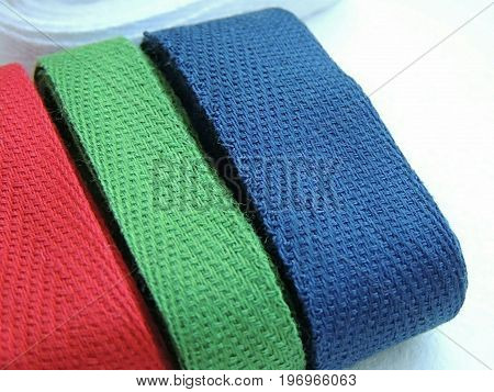 Blue, green, red cotton twill tape for sewing.