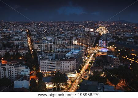 Belgrade, Serbia, July 22, 2017.Aerial  night view of old Belgrade, capital of Serbia with Slavija Square, St.Sava Temple and Avala Tower in the background